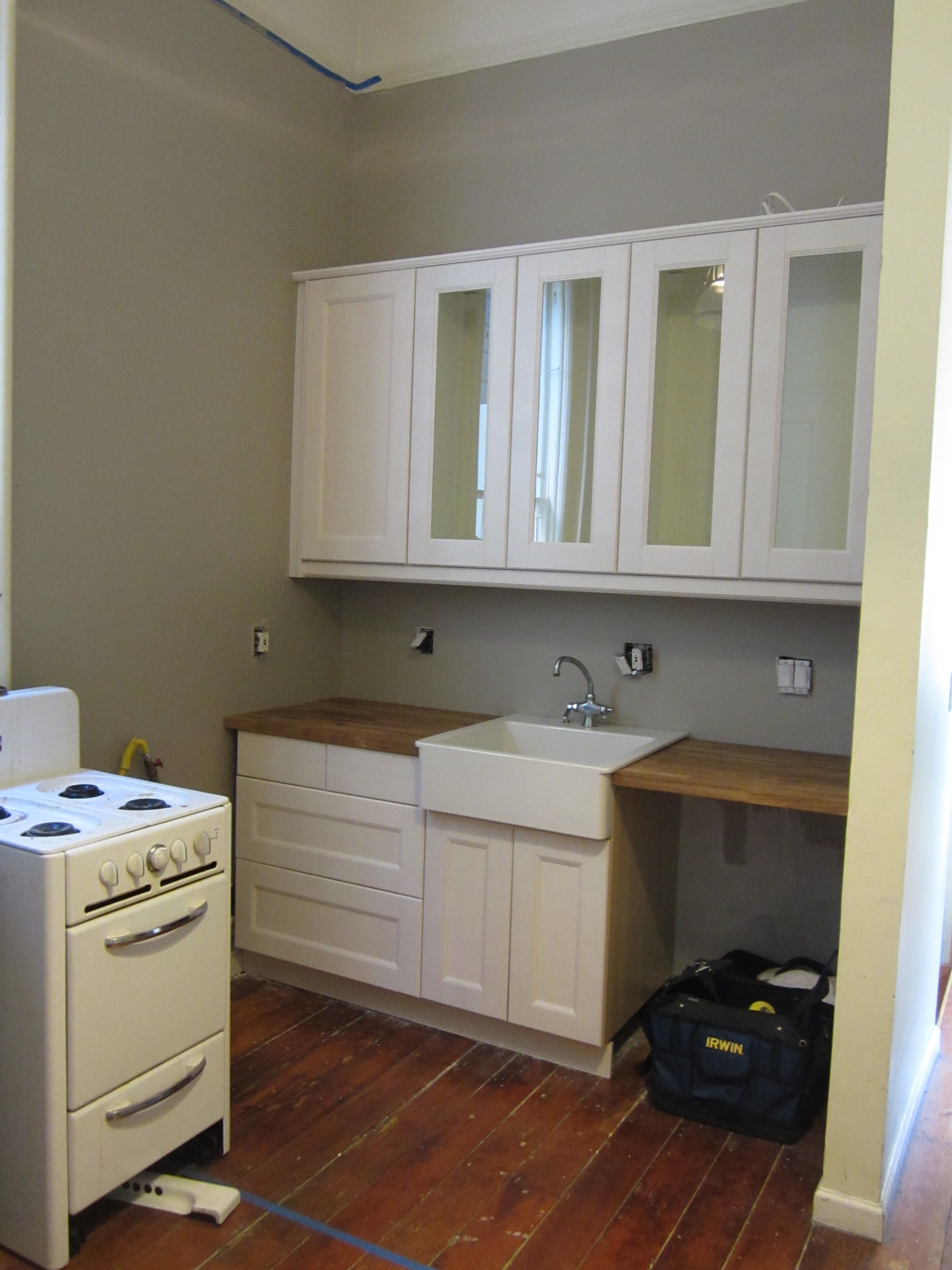 the white cabinets looks super sharp against the grey walls don 39 t you
